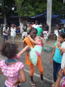 Hanalei and local kids in the street at Bocas Del Toro Carnival 2011